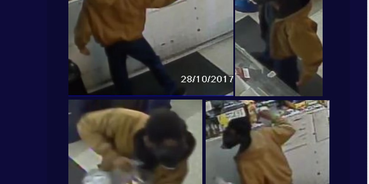 PHOTO: Police need ID of armed robber wearing gas mask
