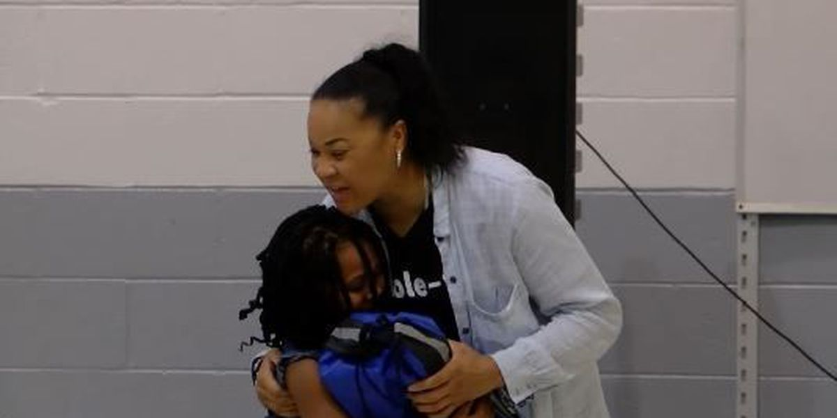 Coach Dawn Staley rewards young students with new shoes