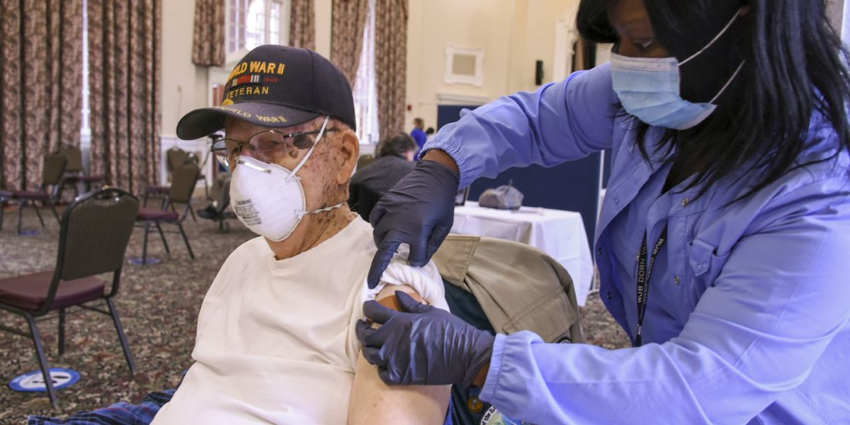 Veterans line up to get COVID-19 vaccines at the Columbia VA