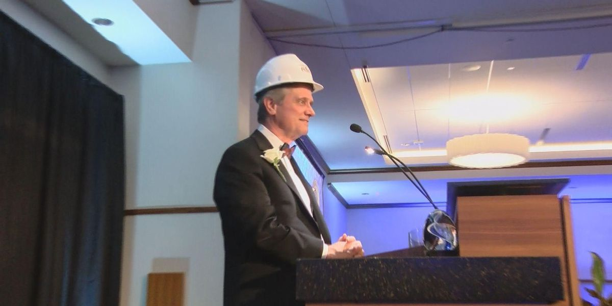Bank president surprised as a Community Builder while attending gala to honor his friend