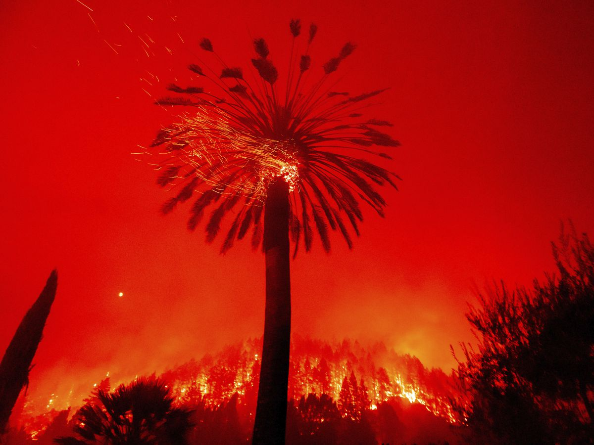 Hot, dry conditions stoke devastating California wildfires