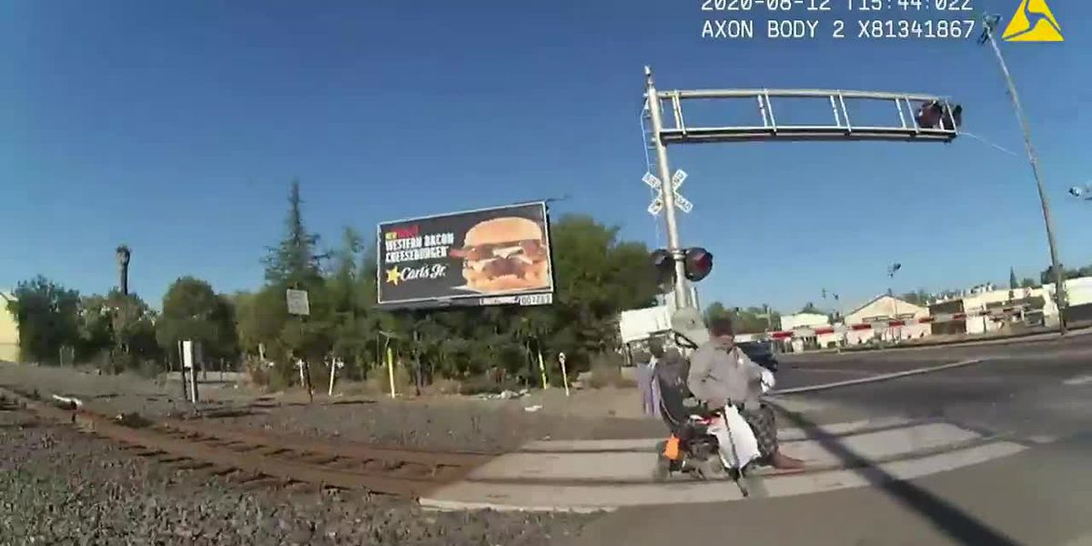 Body camera footage shows Calif. officer rescue disabled man from oncoming train