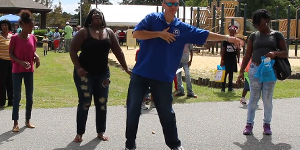 Detective doubles as DJ, dancer at Back to School Bash