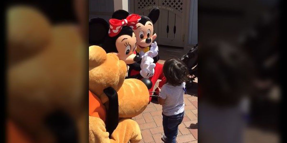 A moment with Mickey, Minnie, and this deaf child will melt your heart