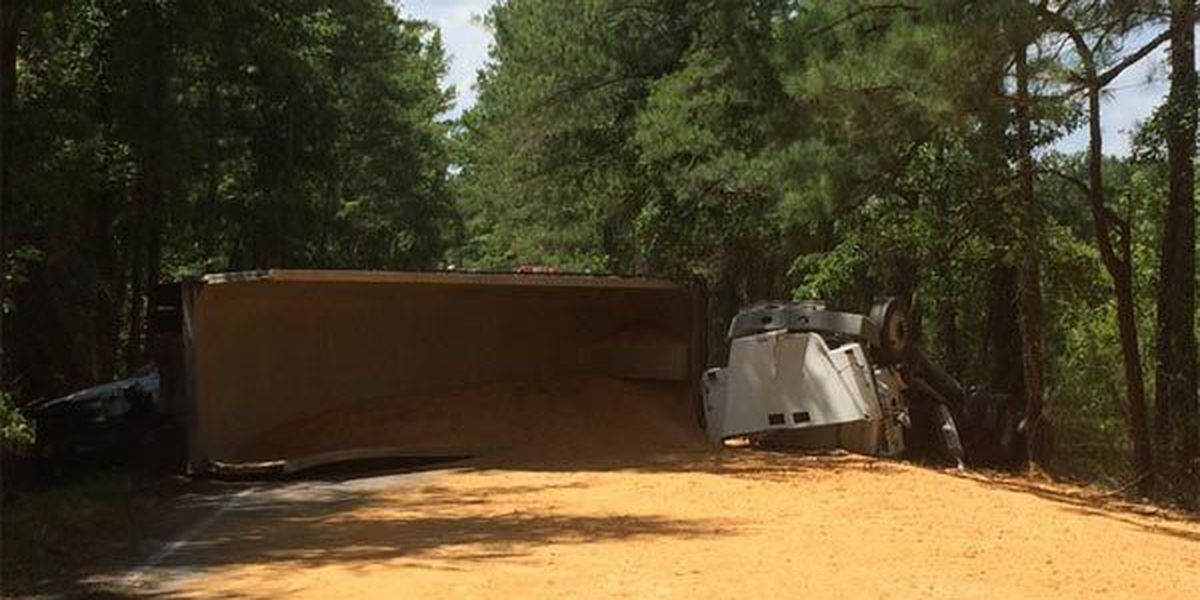 UPDATE: Screaming Eagle Road back open after truck carrying sand overturns