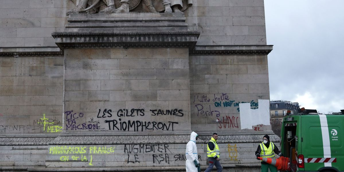 The Latest: Paris police chief says 112 cars torched in riot