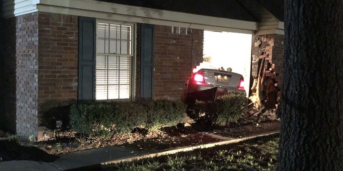 Car plows into family's home, driver hospitalized