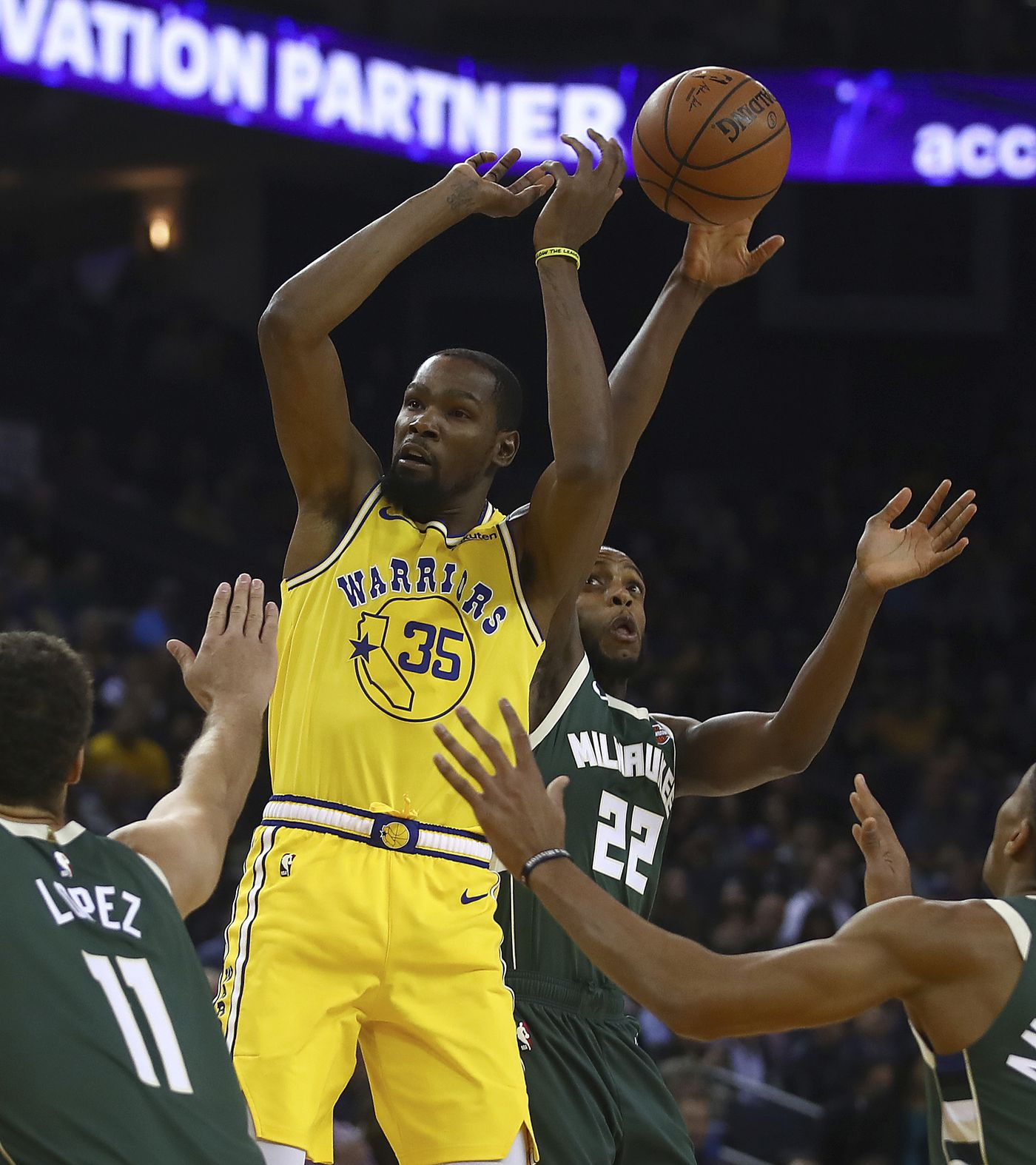 Milwaukee Bucks' Khris Middleton (22) steals the ball from Golden State Warriors' Kevin Durant (35) during the first half of an NBA basketball game Thursday, Nov. 8, 2018, in Oakland, Calif. (AP Photo/Ben Margot)