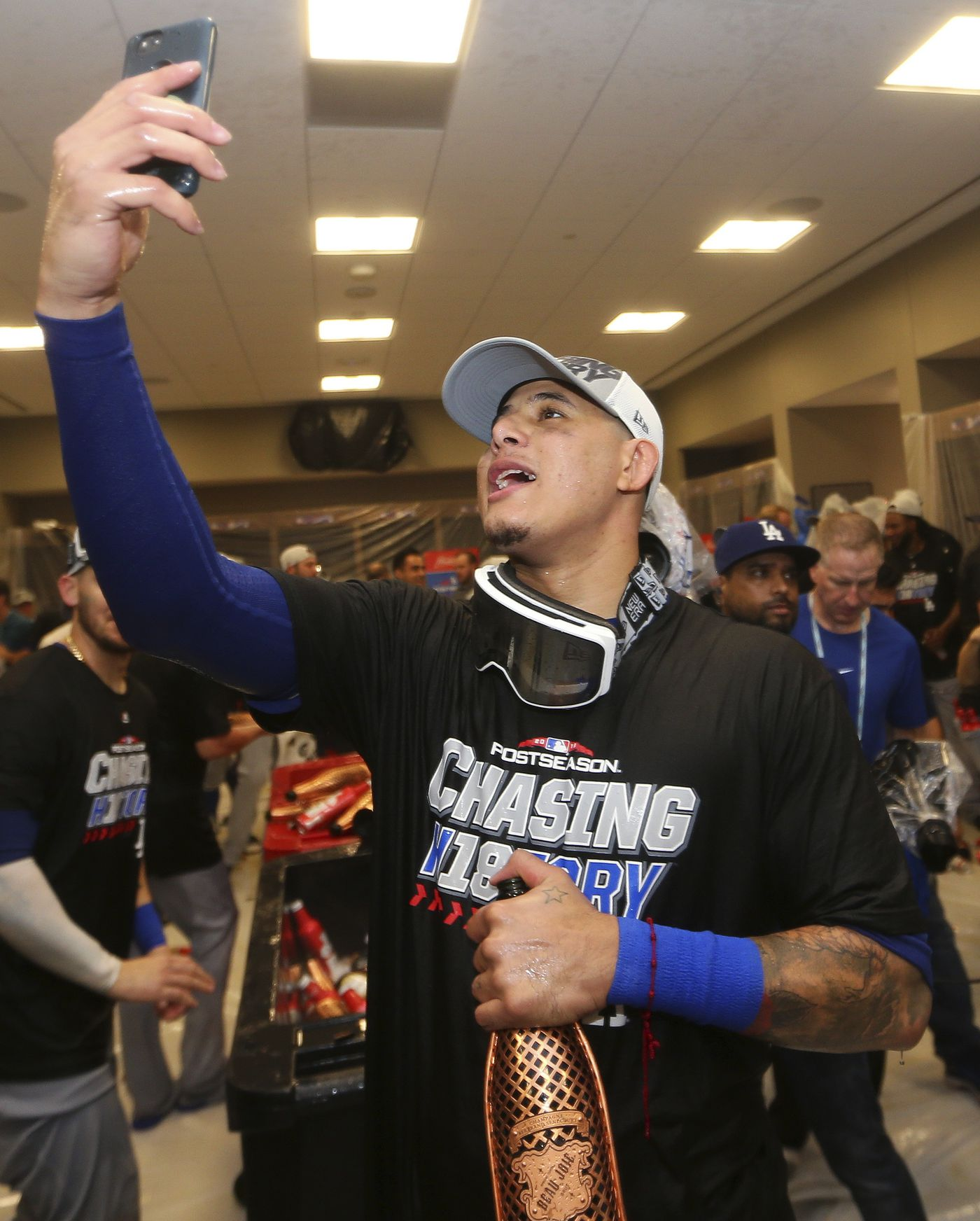 Los Angeles Dodgers Manny Machado takes a photo in the clubhouse after Game 4 of baseball's National League Division Series against the Atlanta Braves, Monday, Oct. 8, 2018, in Atlanta. The Los Angeles Dodgers won 6-2. (AP Photo/John Bazemore)