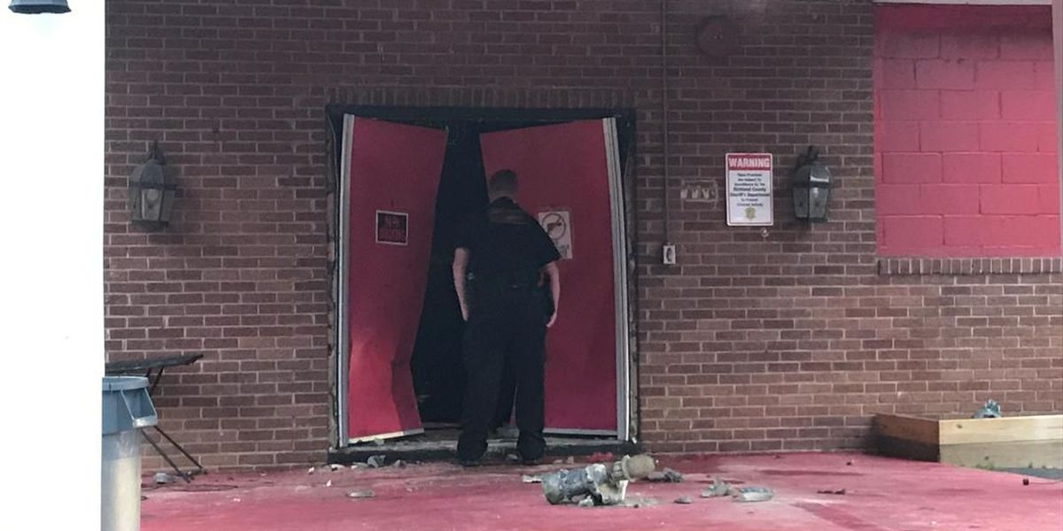 Fire officials: Car crashes into gentleman's club, building catches fire
