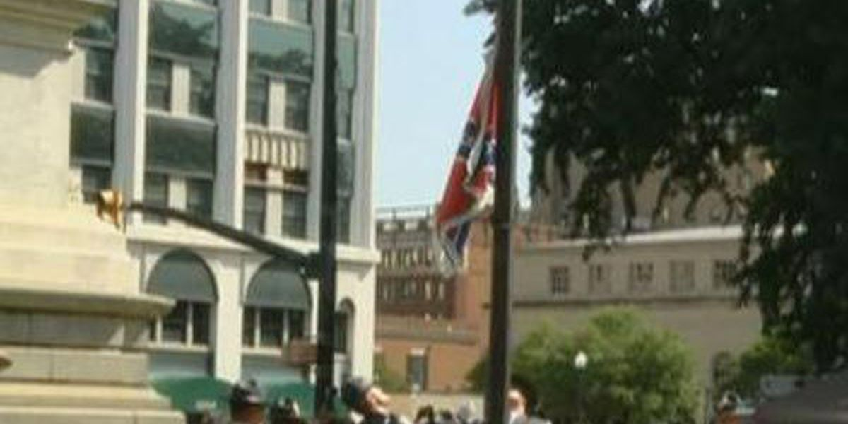 Confederate flag, pole removed from State House grounds