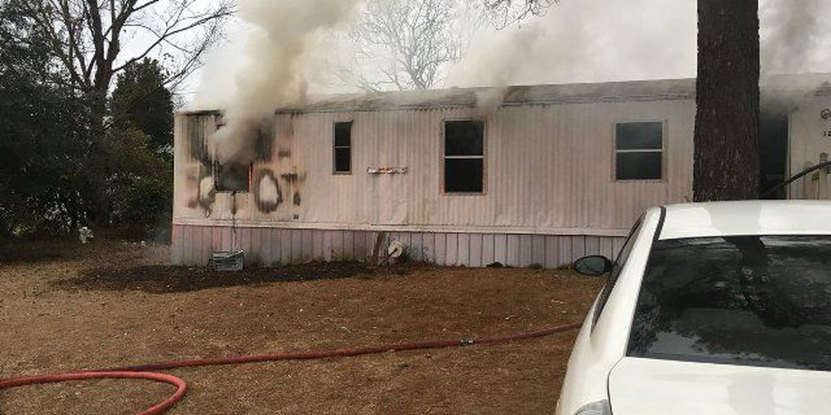 Mobile home fire leaves 5 adults, 3 children with no home