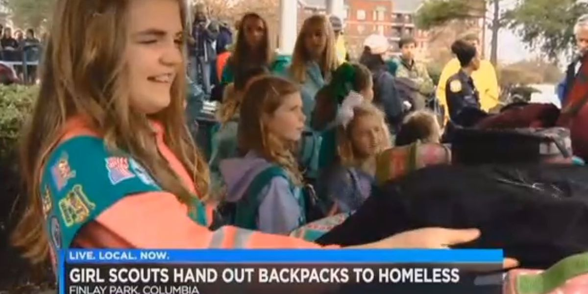 Homeless receives toiletries filled backpacks from Girl Scouts