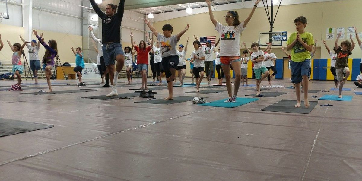 Inner Peace and Pigskin: Gamecocks stop by local camp for yoga session