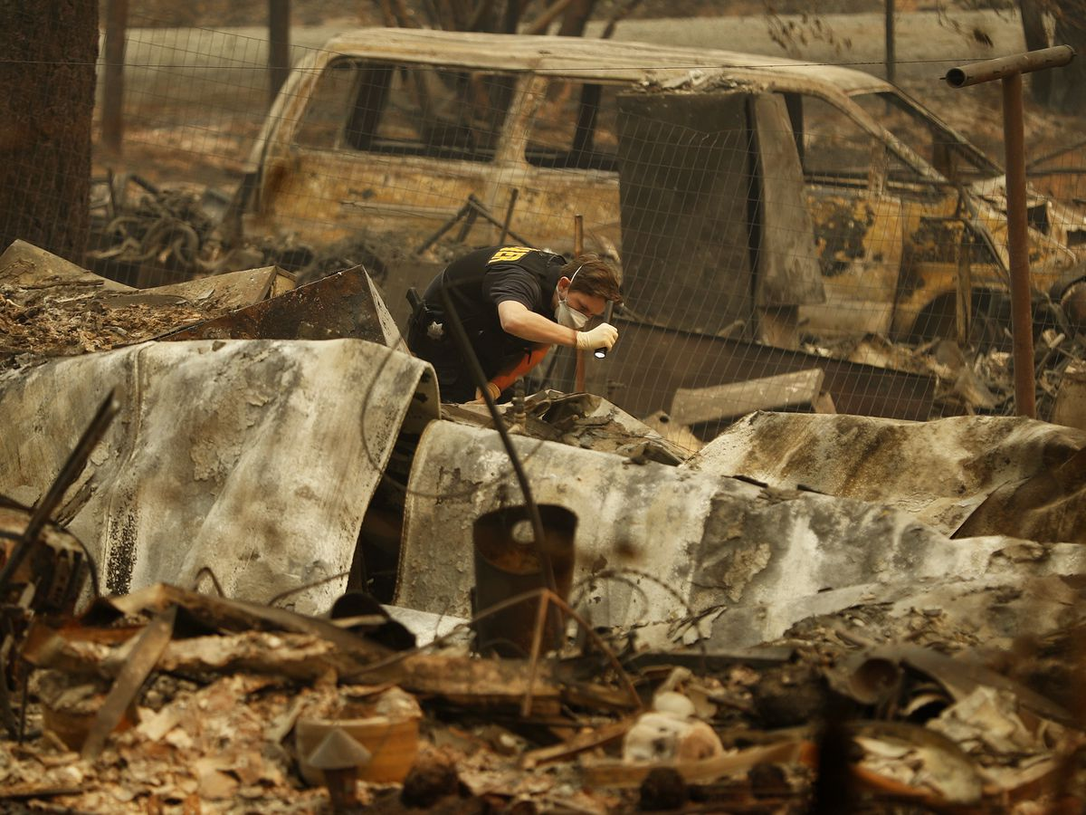 Grim calculus: Coroners search for those killed in wildfire