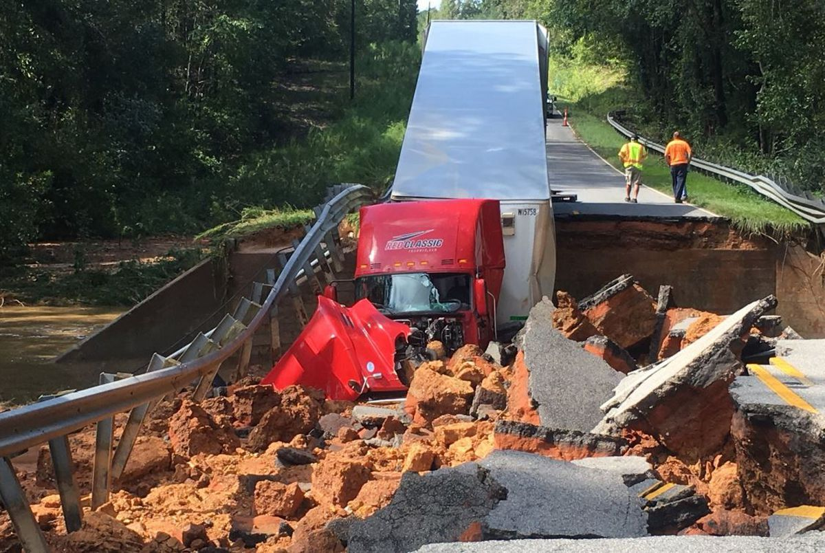 Tractor trailer driving over S  Carolina road as it collapses