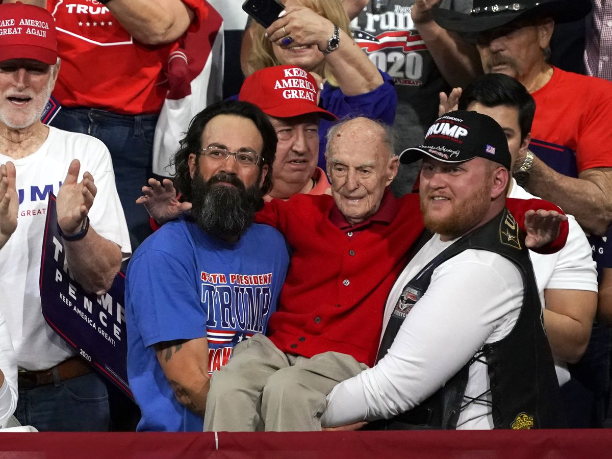 WWII veteran carried to seat at Trump rally in Phoenix