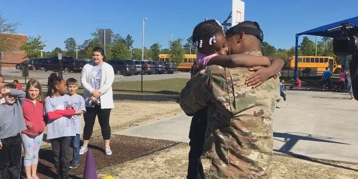 Deployed soldier returns home to surprise daughter at Field Day