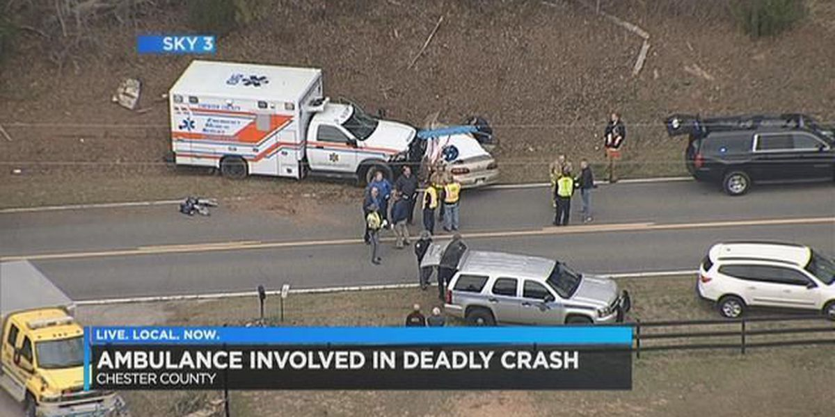 One dead in car crash with ambulance