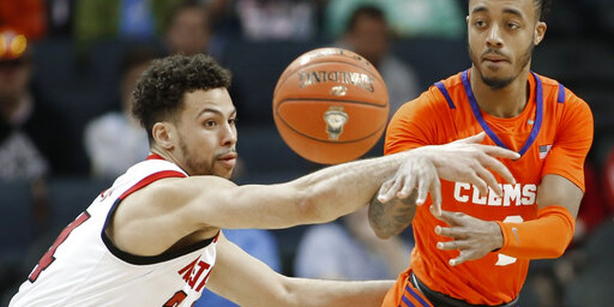 Johnson helps NC State edge Clemson 59-58 in ACCs