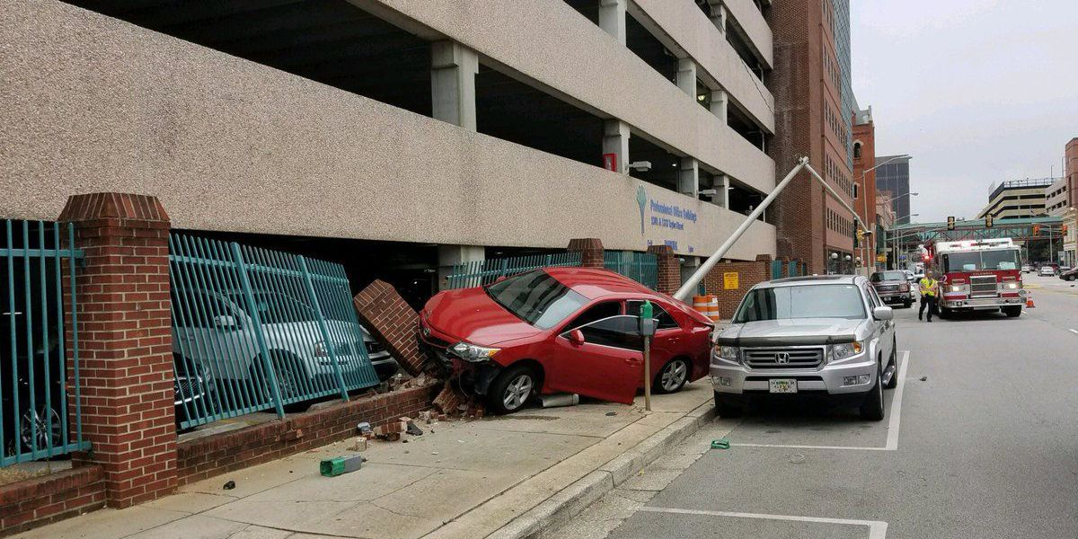 CPD: Car crashed into parking garage to avoid another car
