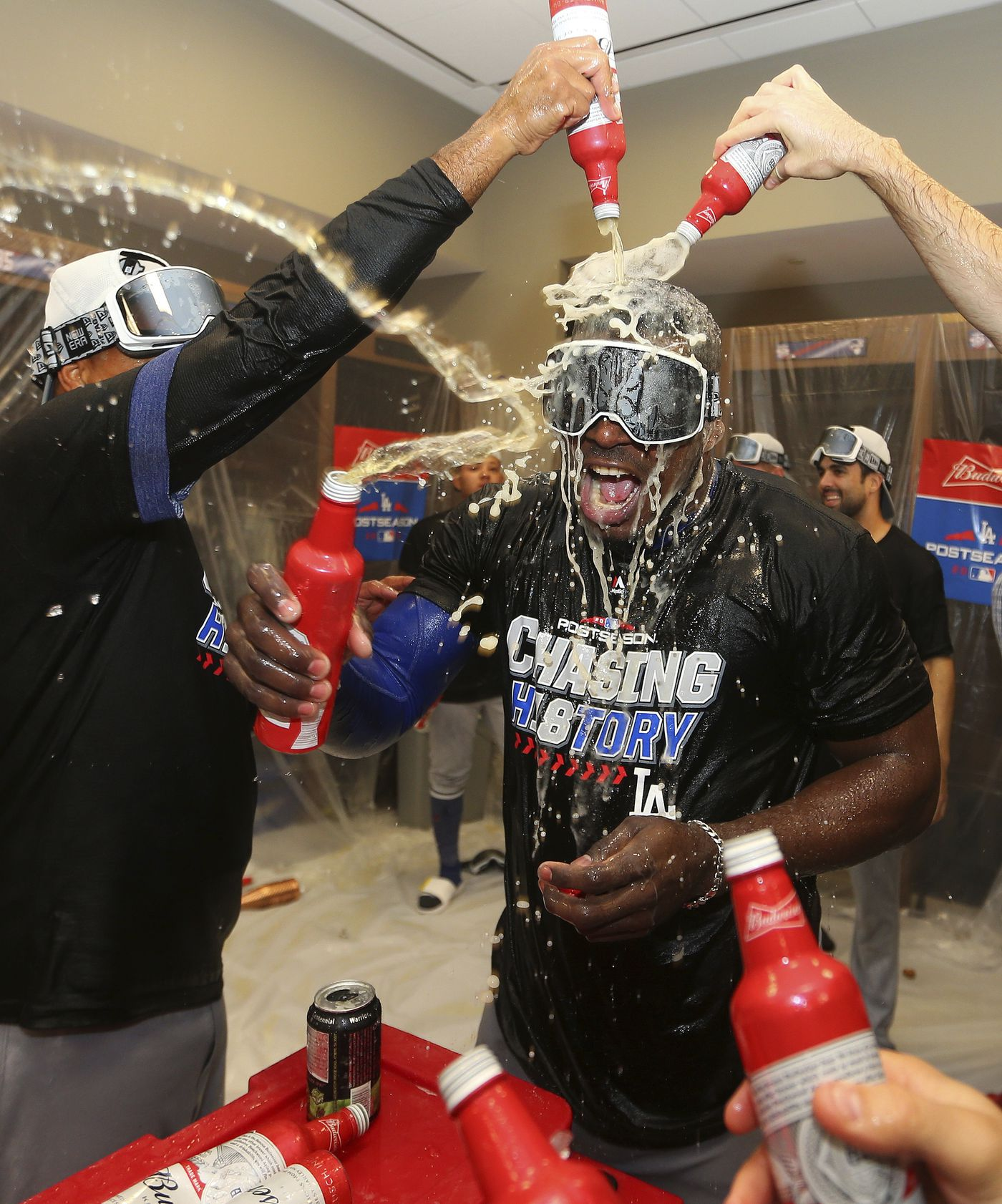 Los Angeles Dodgers' Yasiel Puig is doused after Game 4 of baseball's National League Division Series against the Atlanta Braves, Monday, Oct. 8, 2018, in Atlanta. The Los Angeles Dodgers won 6-2. (AP Photo/John Bazemore)