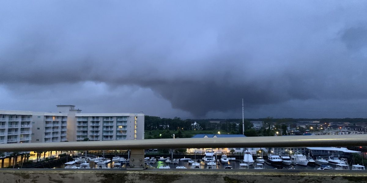 Potential funnel cloud or tornado forms in the sky over North Myrtle Beach