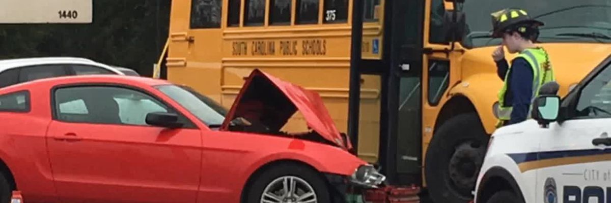 Car crashes into school bus on Broad River Road