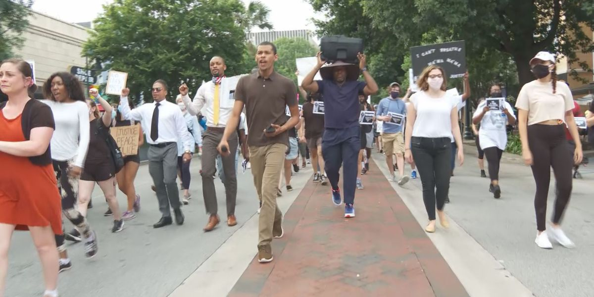 Public defenders, protesters march to state house for justice system inequalities