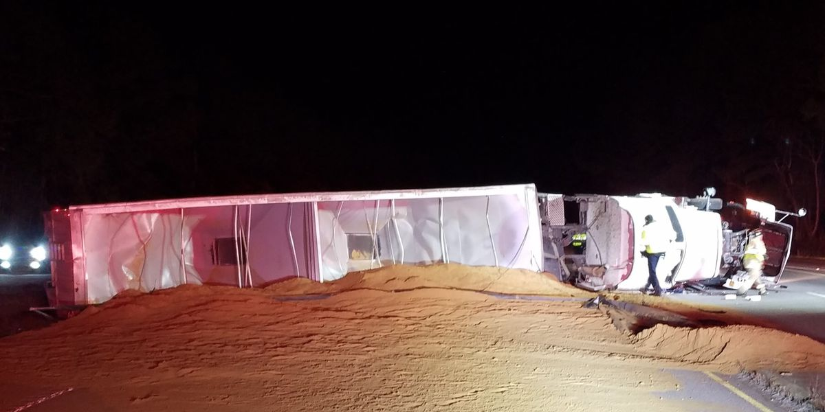 Overturned tractor-trailer carrying chicken byproduct blocks traffic on Garners Ferry Rd. near Hwy. 601