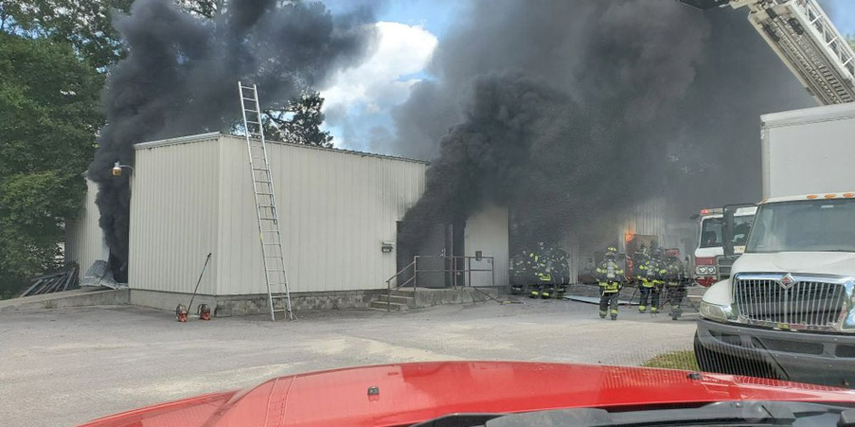 Firefighters extinguish flames at building on Two Notch Road