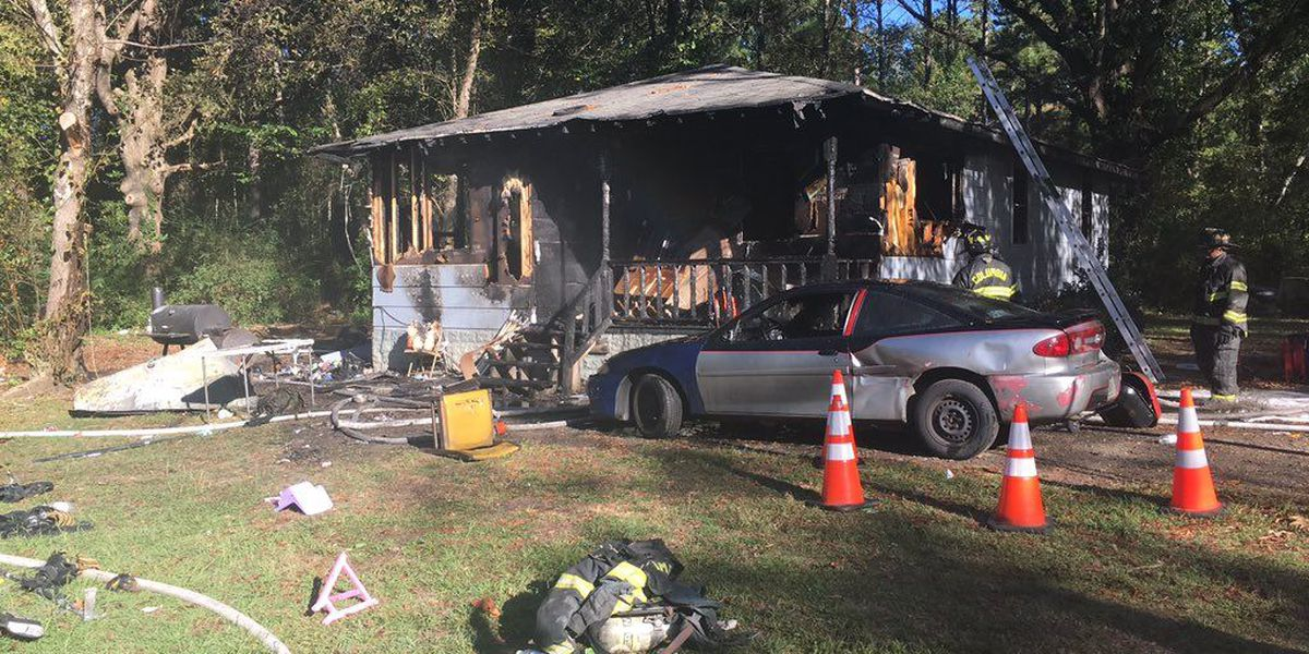 Seven adults, two children displaced following house fire