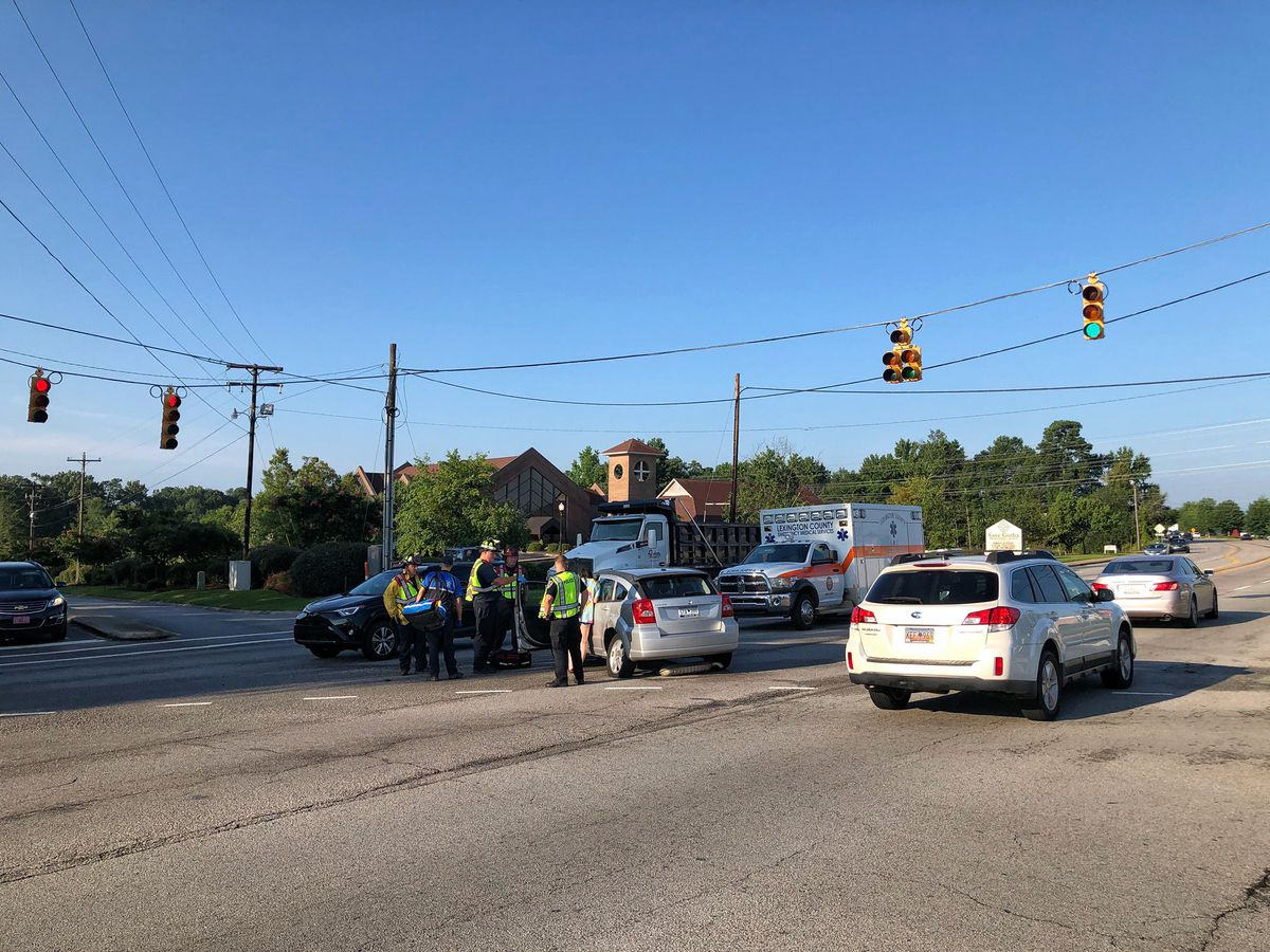 Collision with injuries on Sunset Blvd at Old Cherokee Road causing lane closures