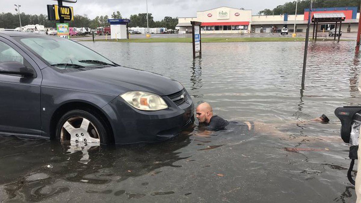 WATCH: Good Samaritan pulls driver stuck in flooded waters to safety