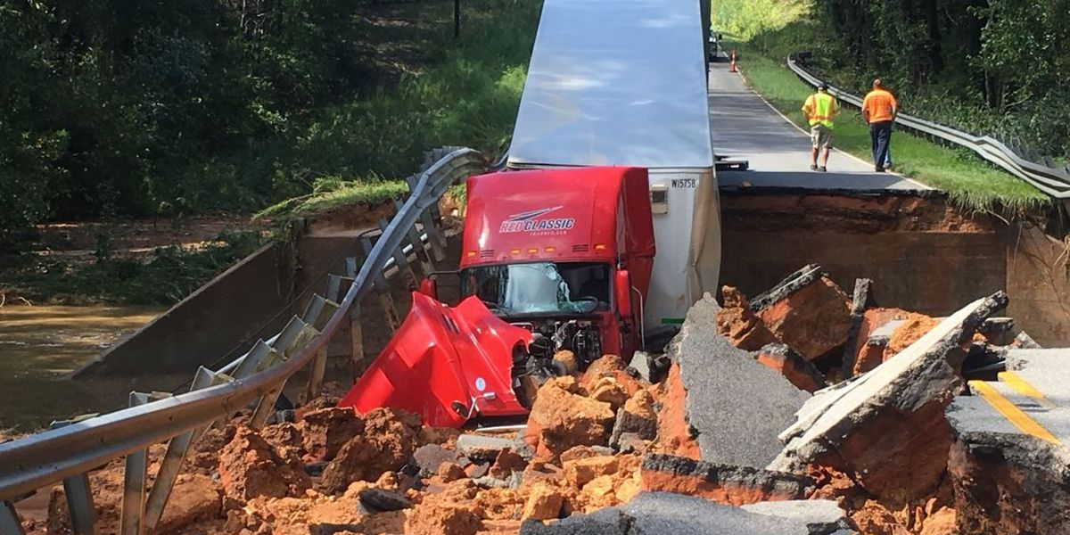 Tractor trailer driving over S. Carolina road as it collapses