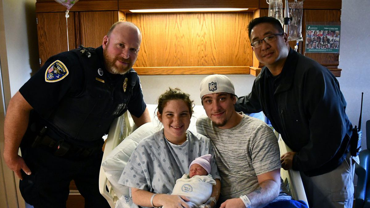 Police officers check-in on family they helped give birth in SC parking lot