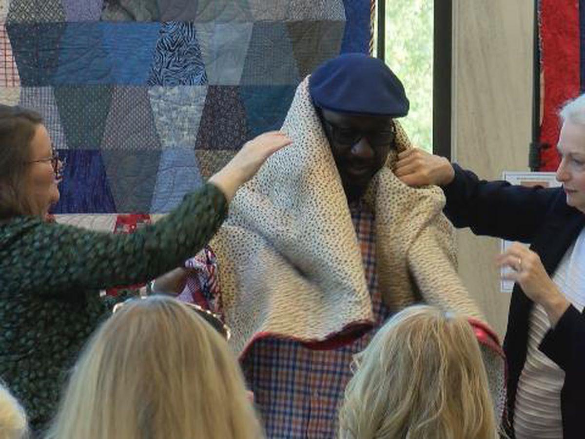 Volunteer organization thanking veterans with quilts