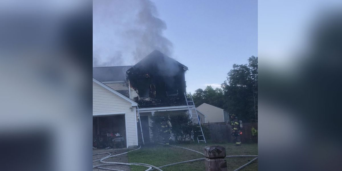2 residents displaced after cigarette lighter causes house fire