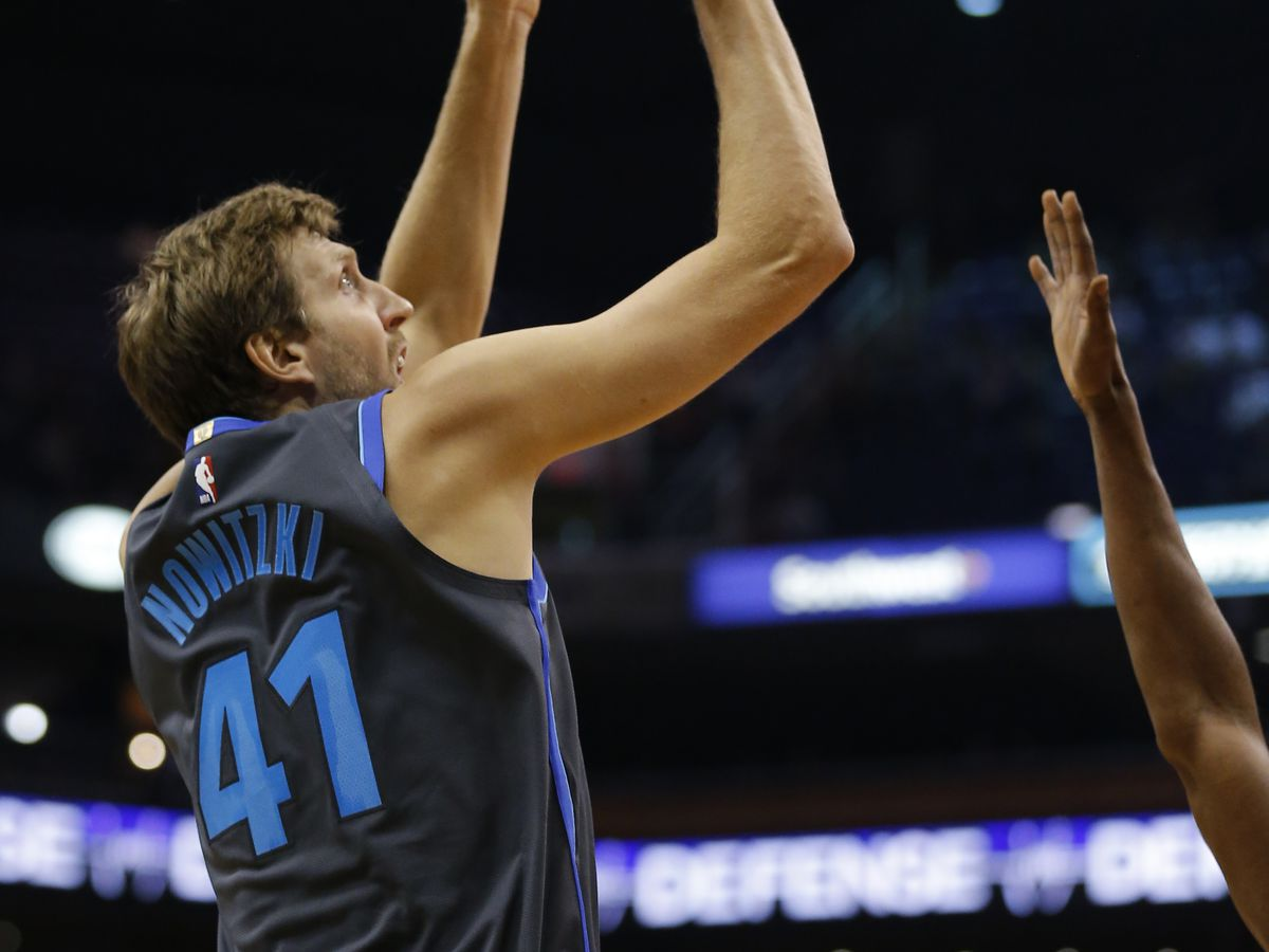 Mavs' Nowitzki makes debut in 21st season vs Suns